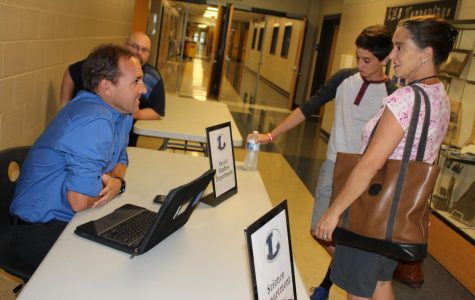 Geography teacher James Allison talks with a parent and student during the first Badgers Connect With Families Night.