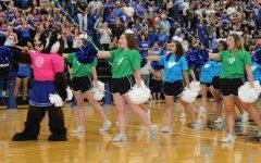 Bailey Badger (freshman Taran Garnett) leads cheerleaders, captain Melanie Burbey, co-captain Makenzie McLendon, Tiana Gurrera, co-captain Victoria Martinez  and Kelcie Roper in the school song at the end of the first pep rally.