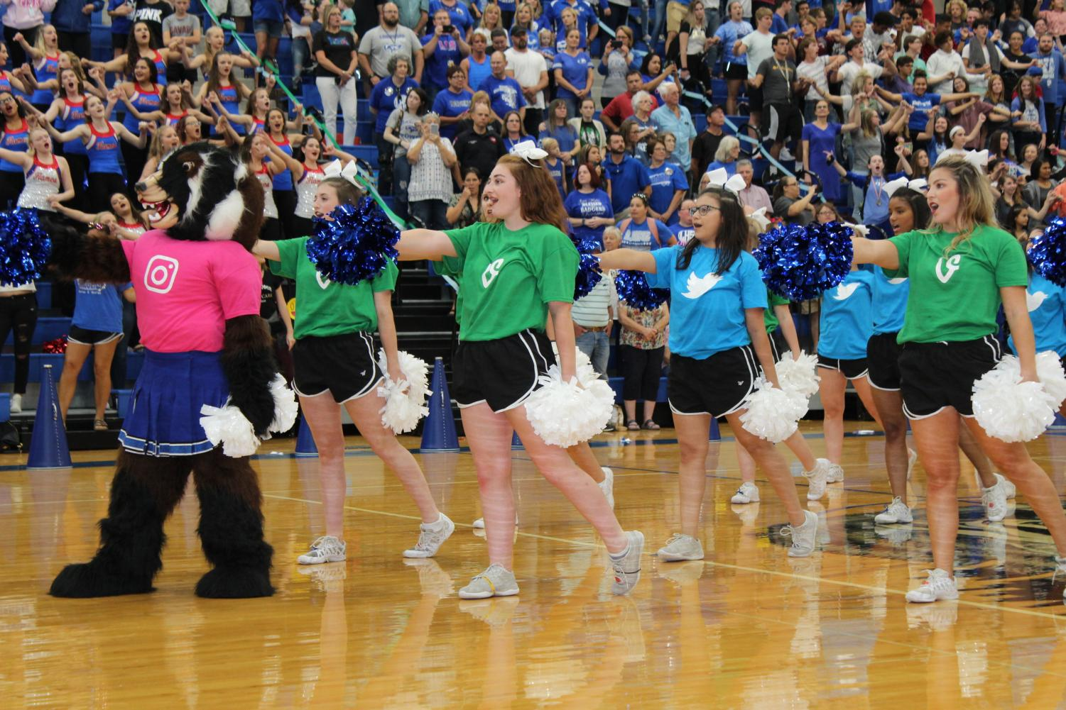 Bailey Badger (freshman Taran Garnett) leads cheerleaders, captain Melanie Burbey, co-captain Makenzie McLendon, Tiana Gurrera, co-captain Victoria Martinez  and Kelcie Roper in the school song at the end of the first pep rally.