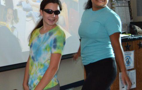 Freshman Alexis Hamilton and Junior Claudia Sanchez dance to