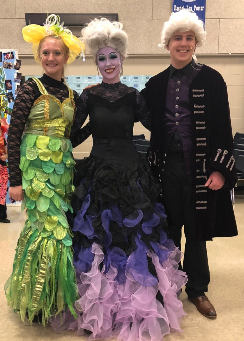 Sophomore Katherine Hansen, senior Makenzie Peacock and sophomore Cole Wheeler mingle with the audience after The Little Mermaid Opening Night Gala Oct. 6.