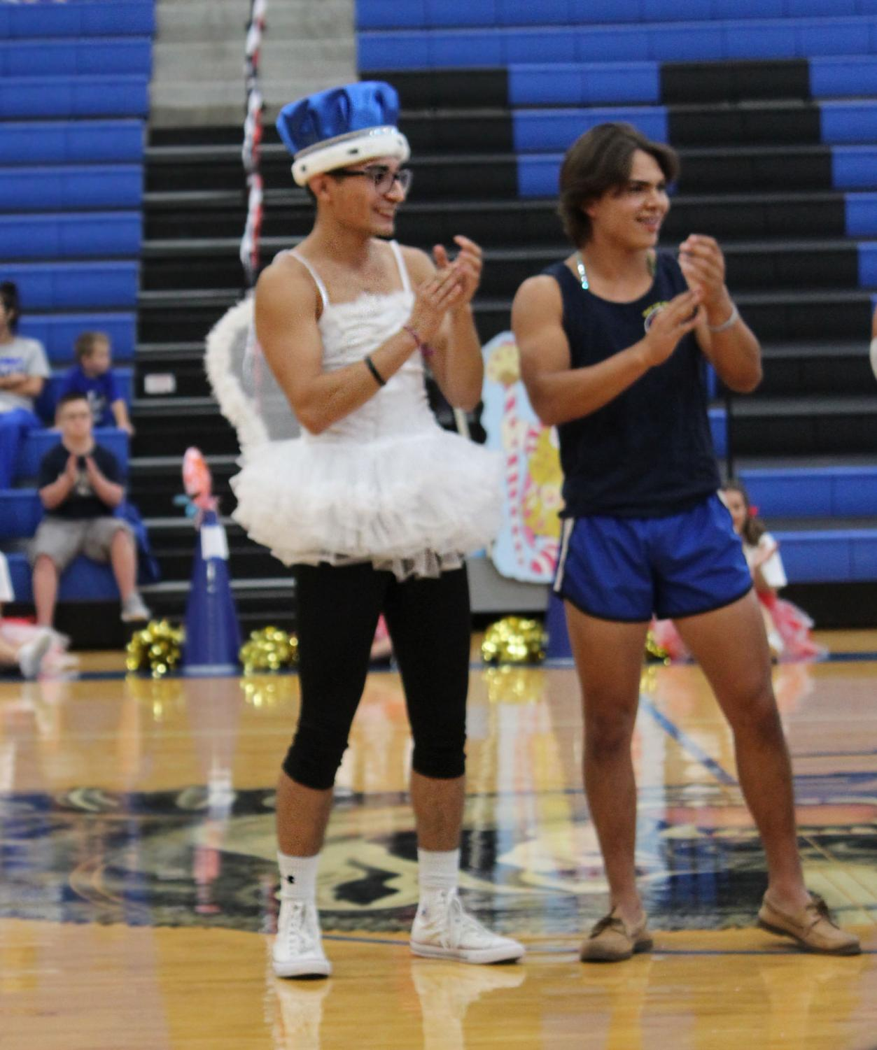 Eric Flores celebrates winning Homecoming King at the end of the pep rally. Moments before, he had performed a baton twirling routine for the talent portion of the