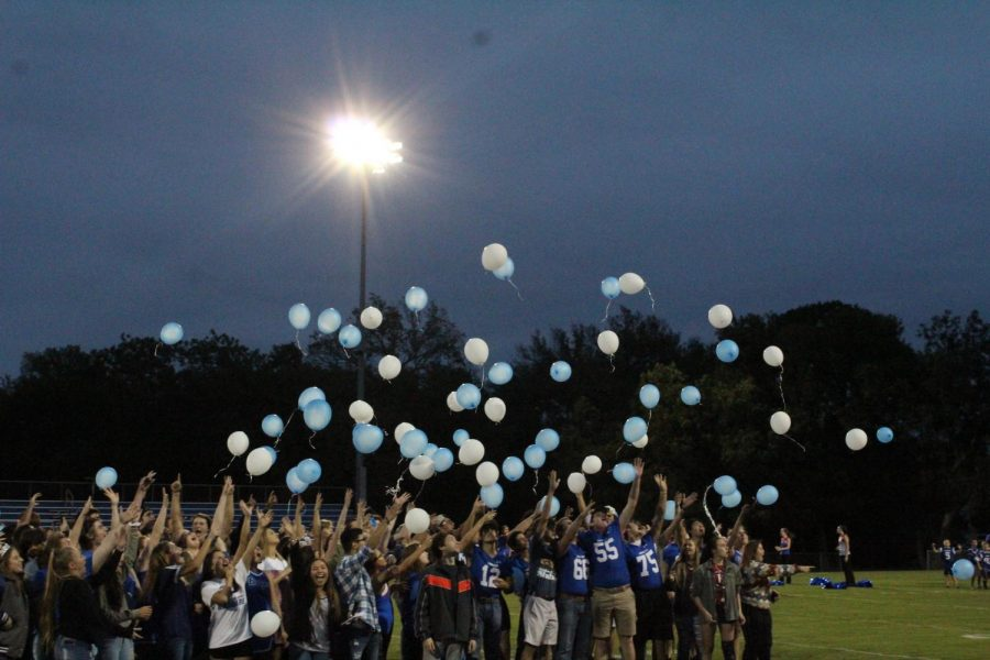 The graduating senior class of 2019 releases their symbolic balloons at the end of the homecoming pep rally. These students will graduate on May 24 at 7:30 p.m.