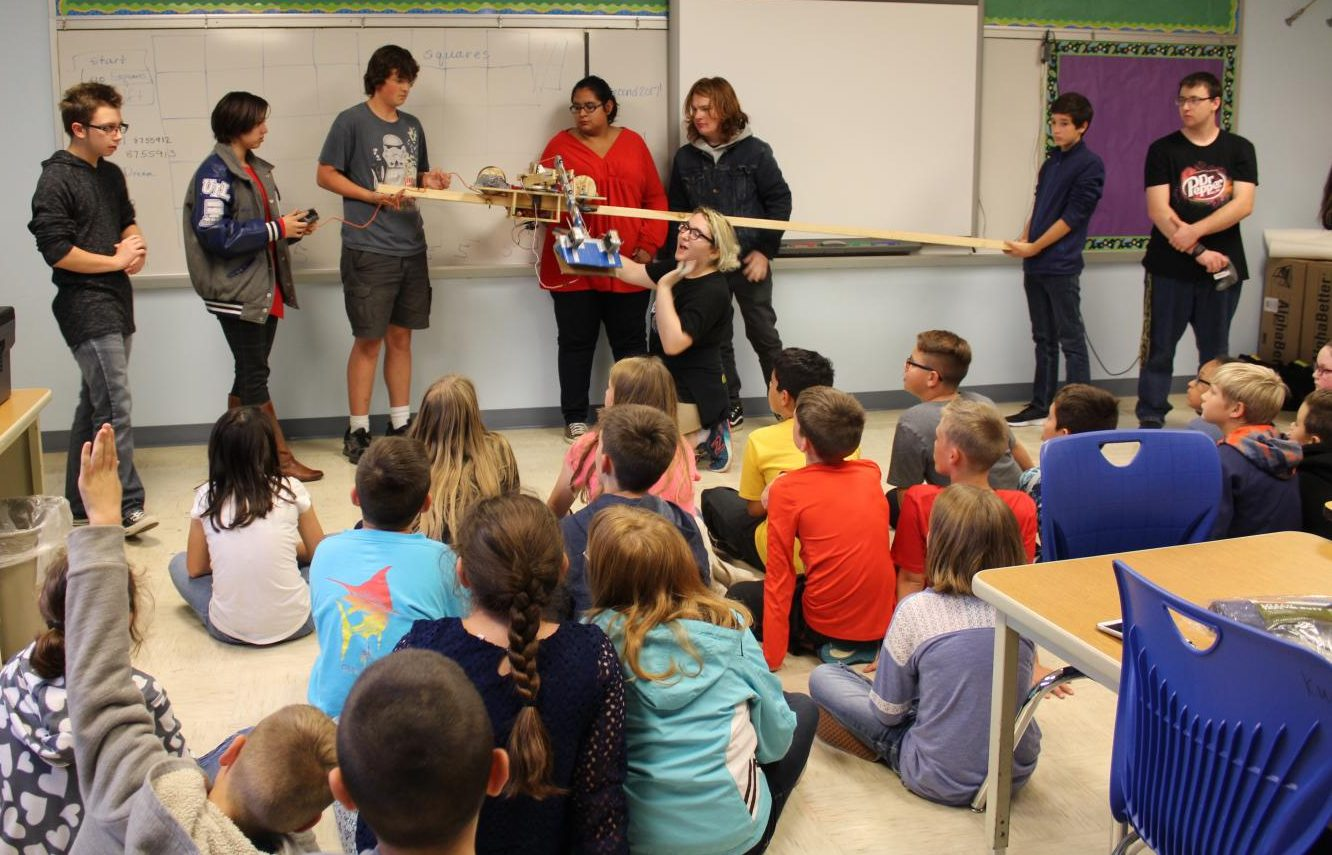 Robotics students share the robot they created with middle school students on Oct. 17.