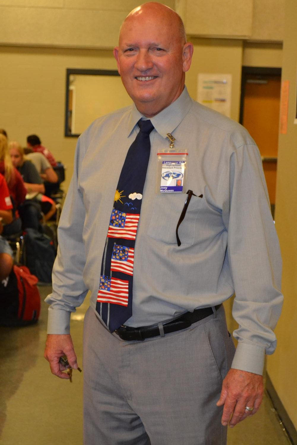 Assistant Principal Joey McQueen poses in the cafeteria with his patriotic neck tie on 'Merica Monday.