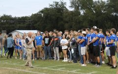Assistant principal  Joey McQueen  speaks to seniors at Badger Stadium  during the senior ceremony pep rally on Sept. 26.