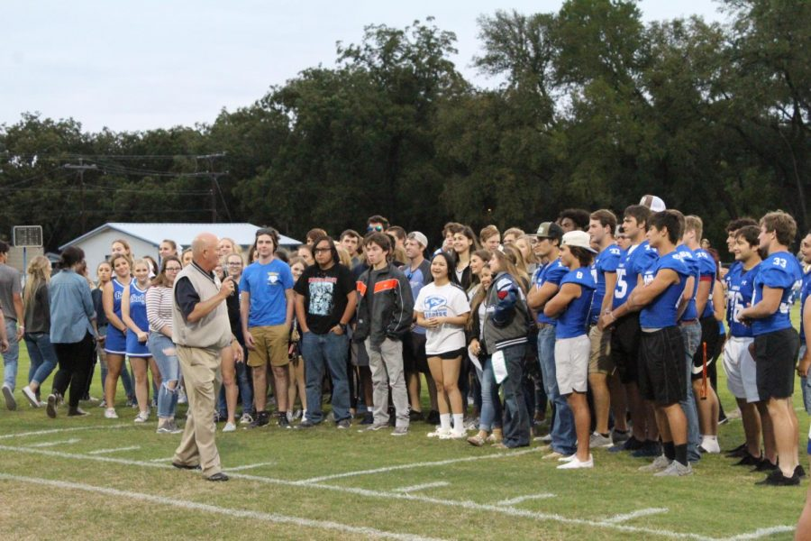 Assistant+principal++Joey+McQueen++speaks+to+seniors+at+Badger+Stadium++during+the+senior+ceremony+pep+rally+on+Sept.+26.+