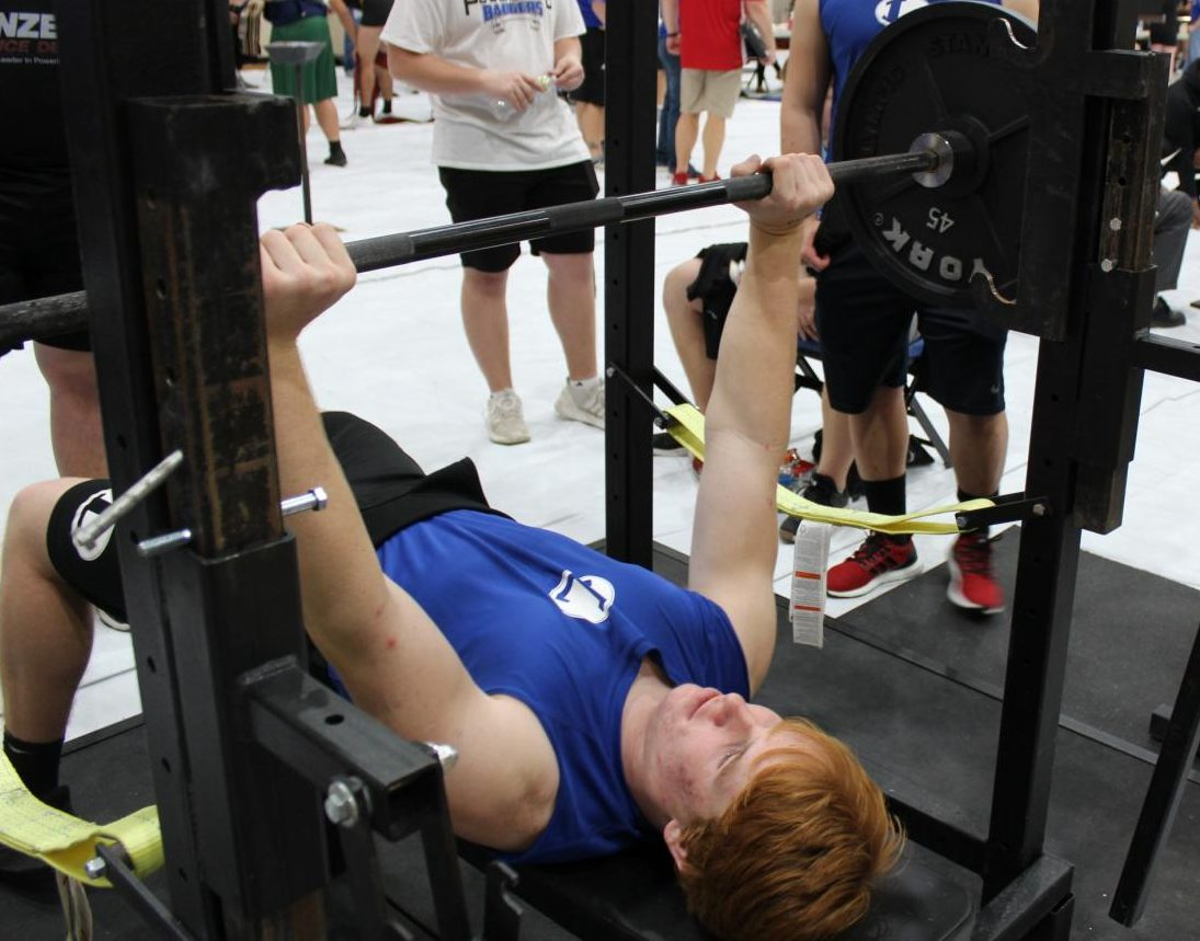 Sophomore Owen Seaver warms up for bench press at the Lampasas powerlifting meet on  Jan. 17.