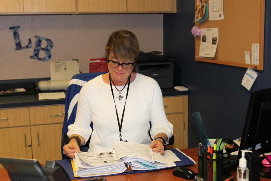 Mrs.+Davis+works+as+registrar+in+her+new+office+between+the+library+and+lecture+hall.+She+was+previously+the+counselors%27+secretary+and+became+the+registrar+at+semester.+