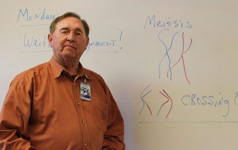 Coach Alford stands in front of his whiteboard full of biology notes. This school year is his 50th year teaching.