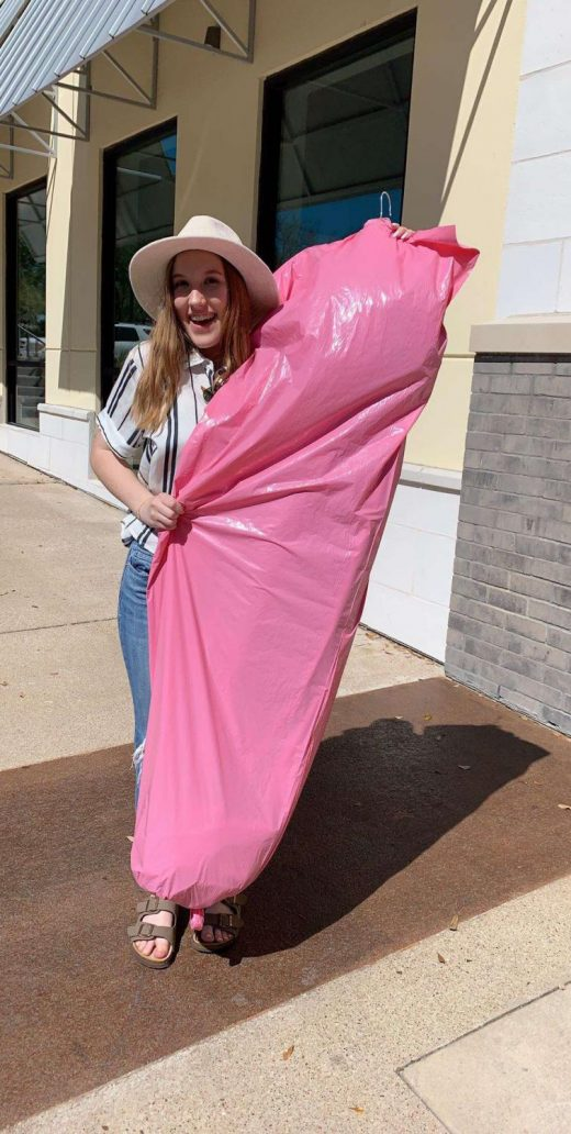 Ferguson holds her new prom dress outside of Z Couture in Austin. LHS Prom is on April 6.