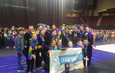 The color guard celebrates  after their state championship performance on March 30.