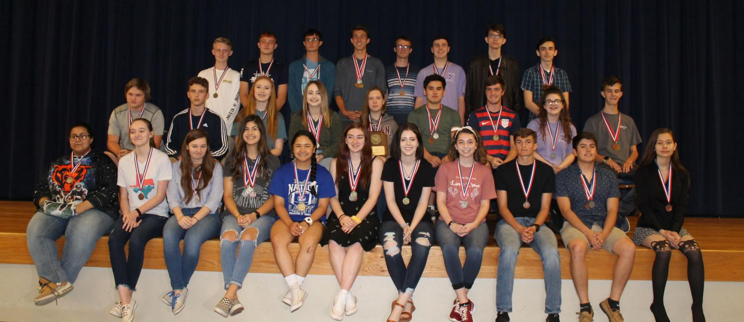 The UIL Academics regional qualifiers pose together with their district medals.