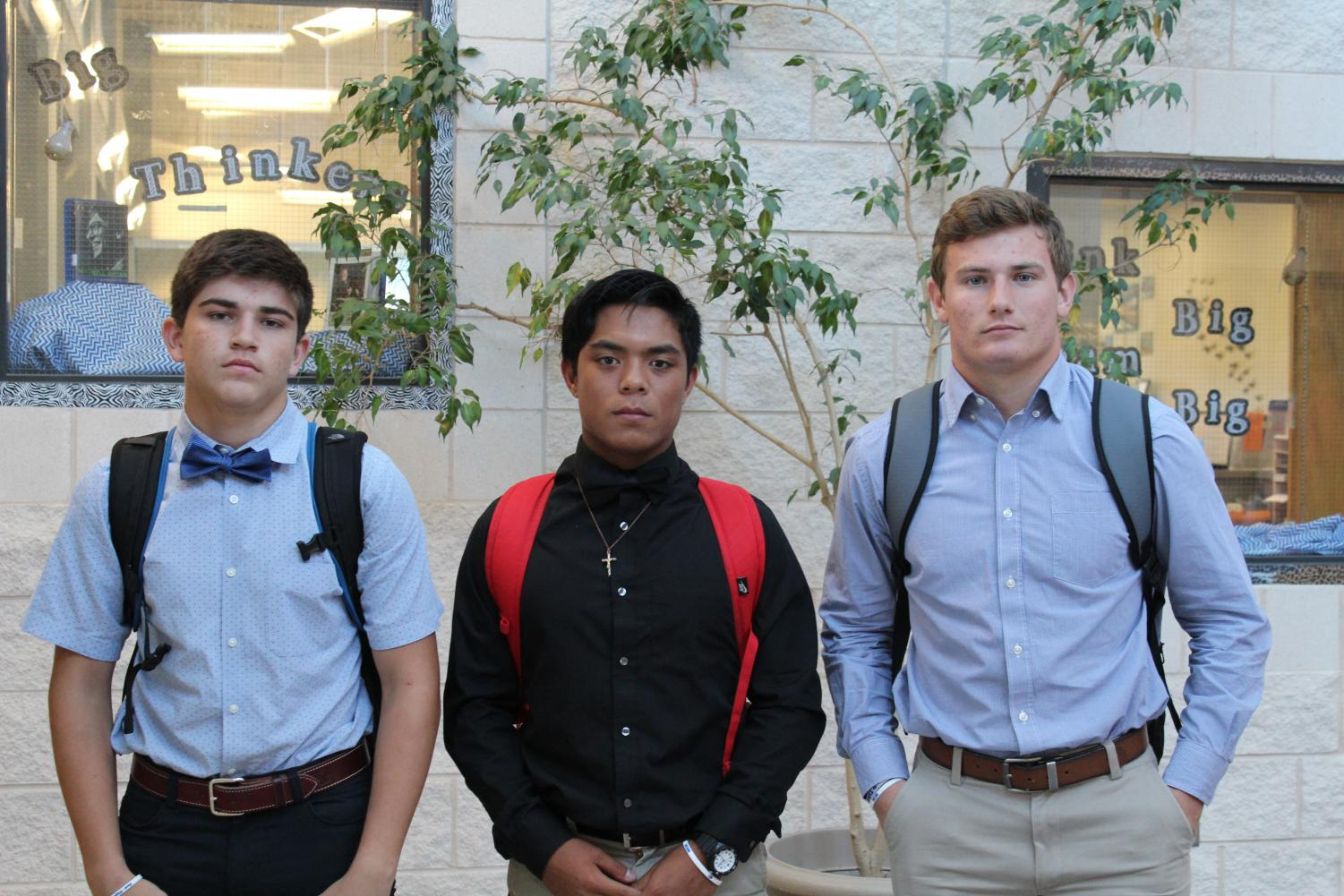 Sophomore Dax Brookerson, senior Kyle Arriola and sophomore Case Brister stop for a quick picture after 8th period as they leave for the first varsity football game of the season in Joshua.