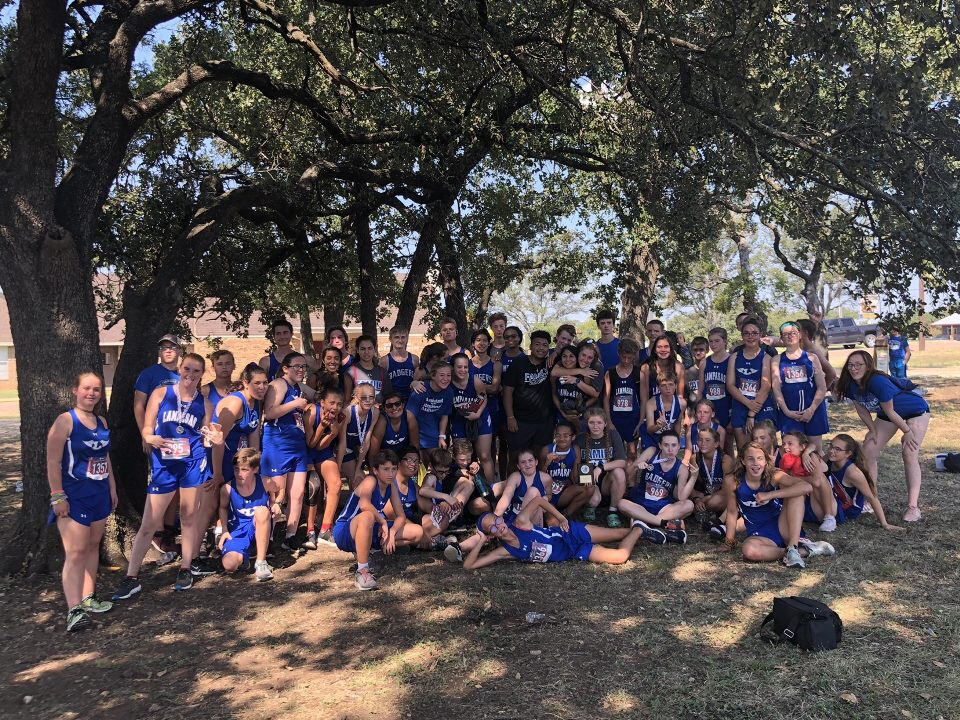 High school and middle school students celebrate together after boys ran 3.1 miles and girls ran 2 miles in Gatesville.