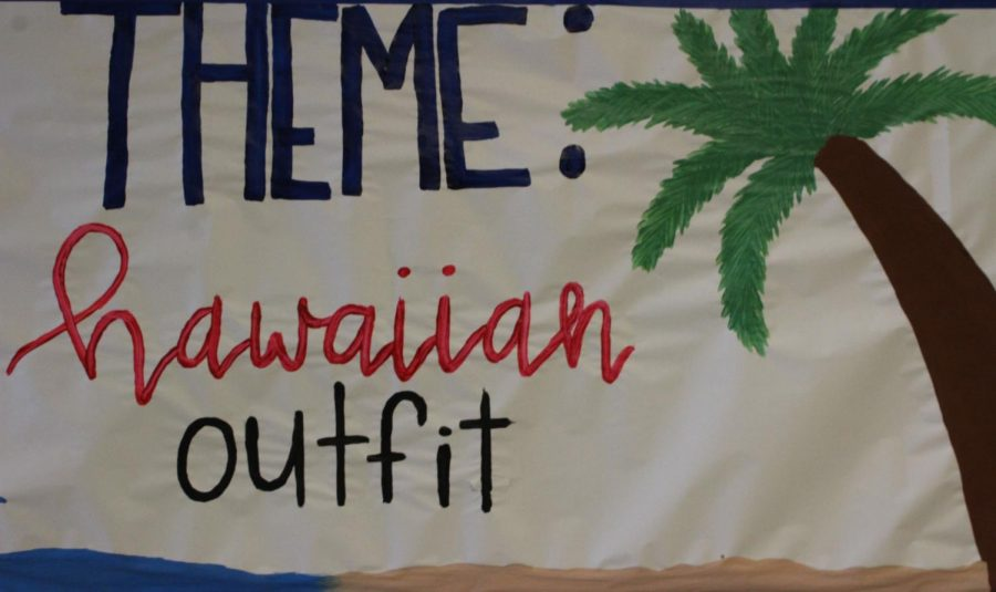 Pep rally sign painted by sophomore Keona Cartwright for tomorrow's theme.