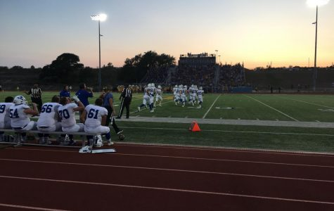 Football players take the field in the first quarter versus the Lago Vista Vikings.