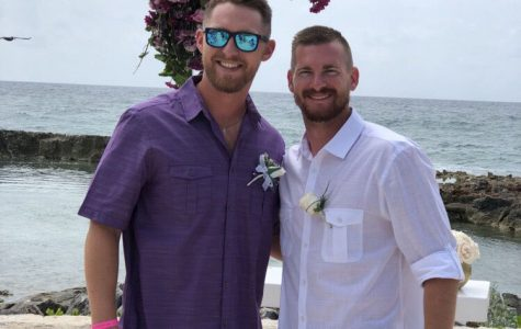 Coach Tanner McLean and coach Logan Simmons smile together at Simmons' wedding in which McLean was the best man.