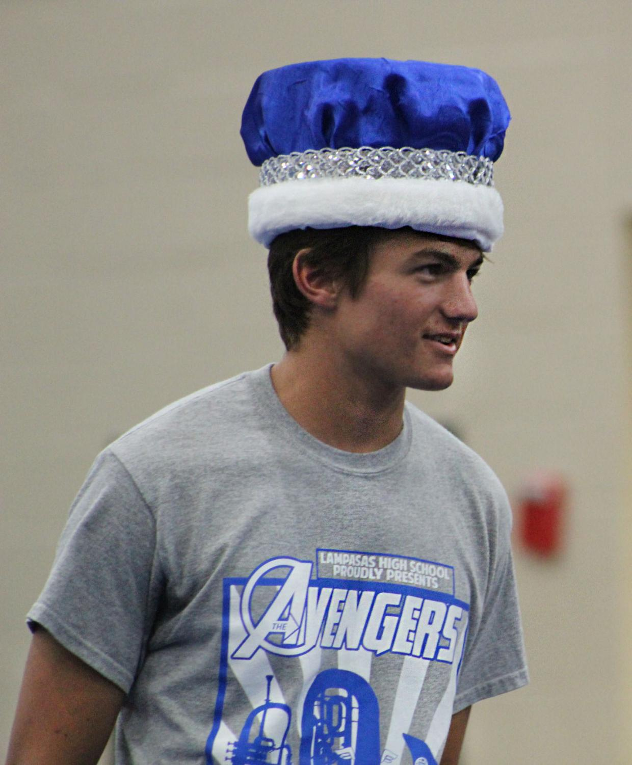 Senior Scooter Cook accepts the homecoming king crown during the pep rally on Sept. 20.