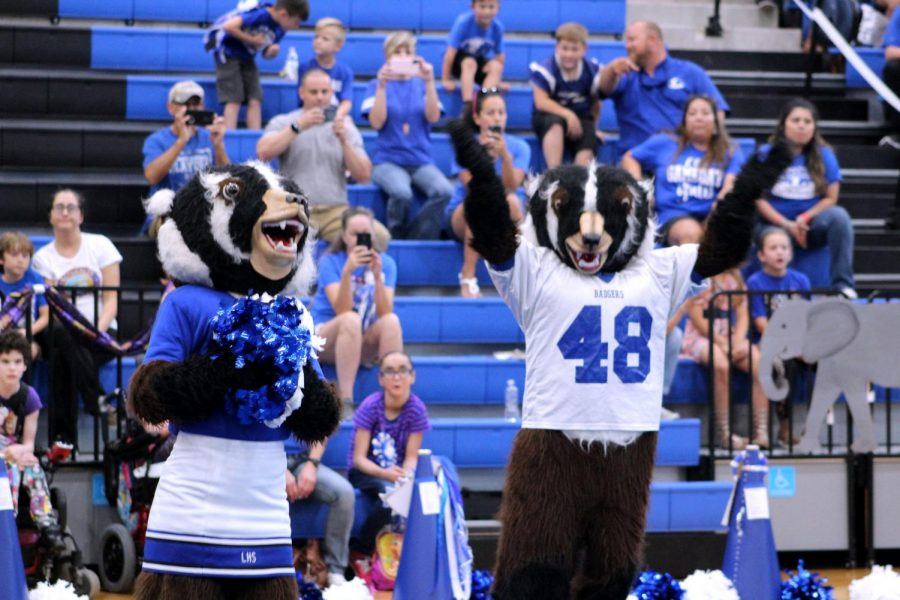 Bailey Badger and Buster Badger cheer for the football team during the homecoming pep rally.  The teams will play Gatesville tonight and tomorrow.