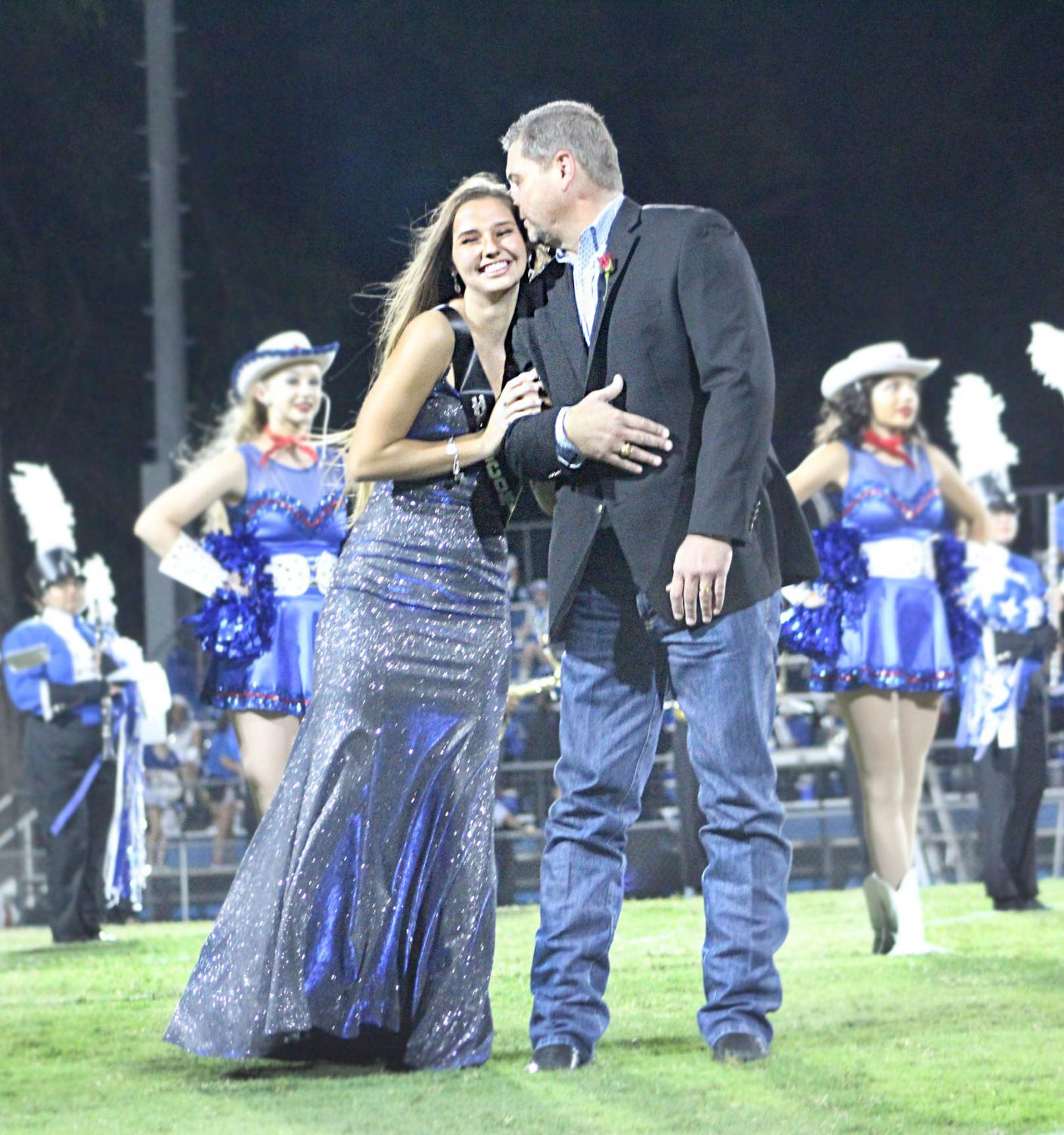 Jessica Ball hugs Sid Ball as she is announced homecoming queen.