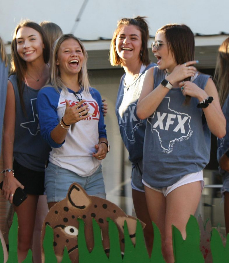 Juniors+Kerbi+Wiley%2C+Amberly+Adams%2C+sophomore+Rebekah+Pearce+and+junior+Brinley+Klosterhoff+enjoy+riding+on+the+XFX+float+during+the+homecoming+parade.+