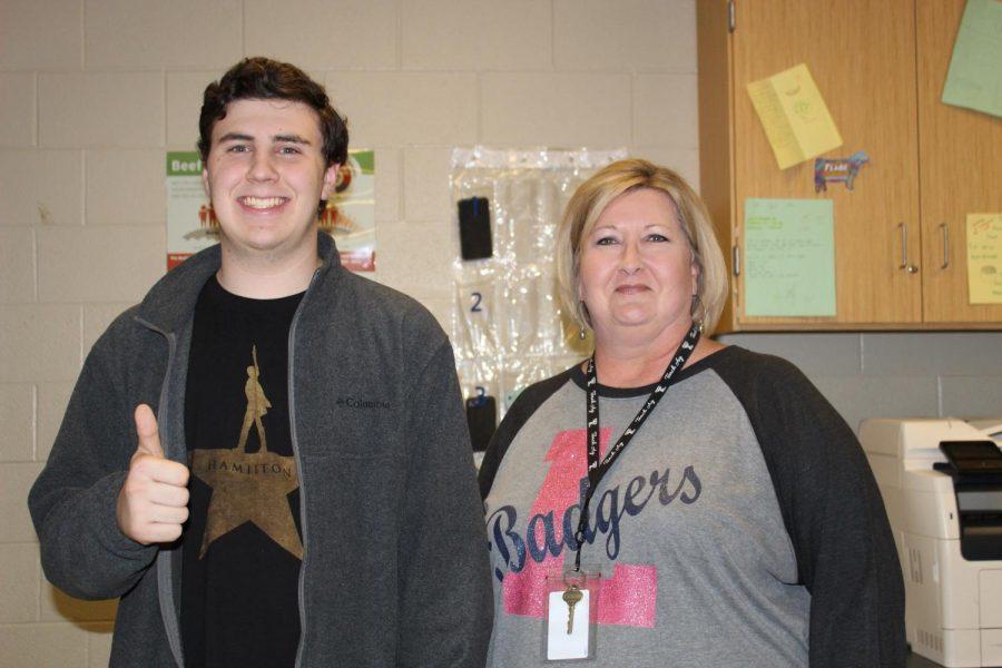 Junior Cole Wheeler stands with agriculture teacher Judy Hail. Wheeler earned the Texas Farm Bureau Youth Leadership scholarship.