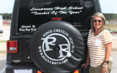Kalin Wells, who was one of the teachers of the year, received a Jeep from Benny Boyd to drive for one month.