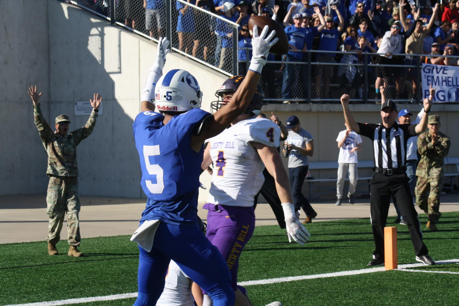 Senior Jaylon Porter and Badger football fans celebrate a touchdown against the Liberty Hill Panthers on Dec. 7.