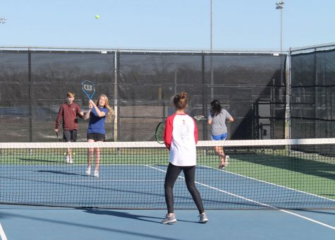 Freshman Haylee Finley practices with the JV tennis team Jan. 24.