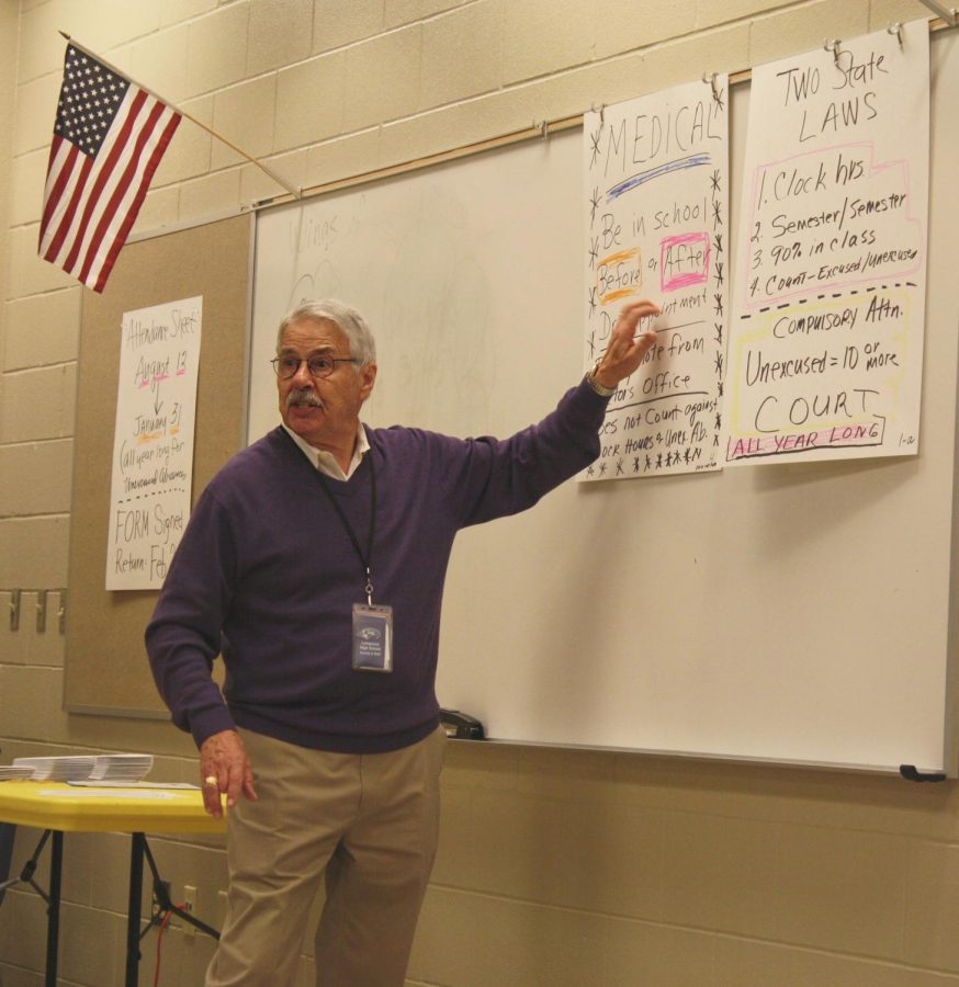 Attendance clerk Dick Parker speaks to students with an excessive amount of unexcused absences Feb. 14 during academic period.
