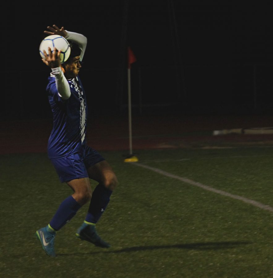 Junior Victor Castruita throws the ball into play on the field during the varsity soccer game on Jan. 28 at home. The boys took home a win of 9-0 against Florence.