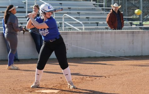 Senior Hannah Greenberg loads up as she prepares to hit the softball at practice Feb. 6.