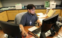 Attendance clerk Jesse Tyler Castenada works at his desk March 4.