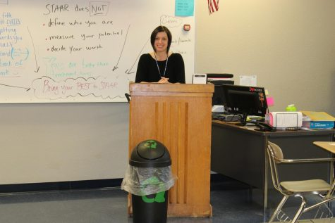 English teacher Jennefer Moore keeps a recycle bin in her classroom in hopes that the high school will begin recycling.