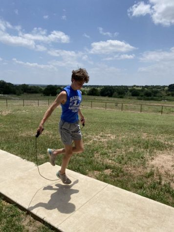 """Sophomore Nate Borchardt physically trains at home due to COVID-19. """"Limited"""" public UIL athletic training may begin June 8."""