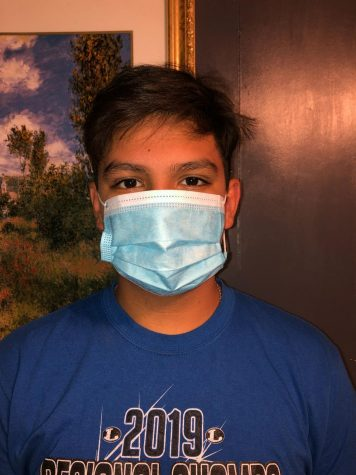 Eighth grade student Benjamin Ybarra wears a mask.Young people and old people alike need to take heed to health officials' advice and just simply stay home, stay safe and help health care providers by slowing the spread.