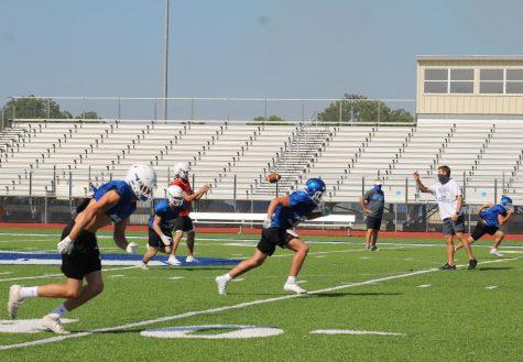 The football team practices after school. The first football game of the season is tomorrow at 7 p.m. at Badger Stadium.
