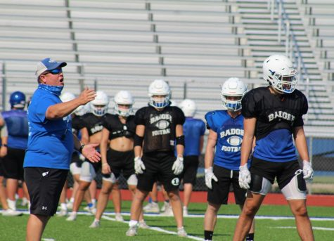 Coach David Brister talks to players on special teams lining up at after school practice Aug. 19.