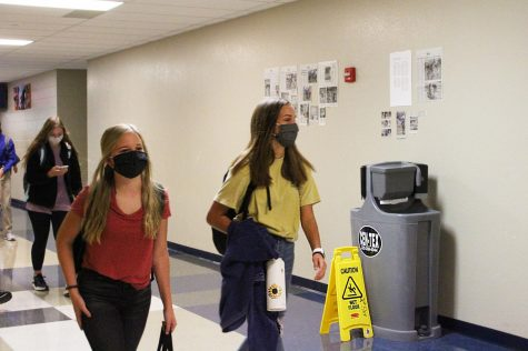 Freshmen students walk past the new hand washing station on the way to second period Aug. 27.