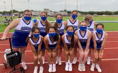 The JV Blue team cheers for the JV football team.
