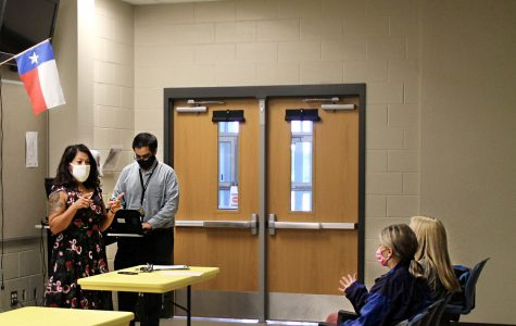 Student council advisor Elma Garnett talks to senior treasurer Kellie Kozma during the student council meeting Sept. 21. This was the first meeting since officers were elected.