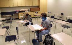 Interventionist Sandra Bobo tutors freshman Martin Small.