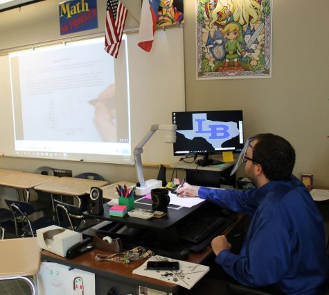 Math teacher Jesse Cox teaches AP statistics under his document camera. He often uses this method to record his lessons for virtual students.