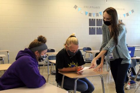 NHS sponsor Alison Brayton talks with NHS members, junior Saydie Smith and senior Madelyn Hess during academic period.