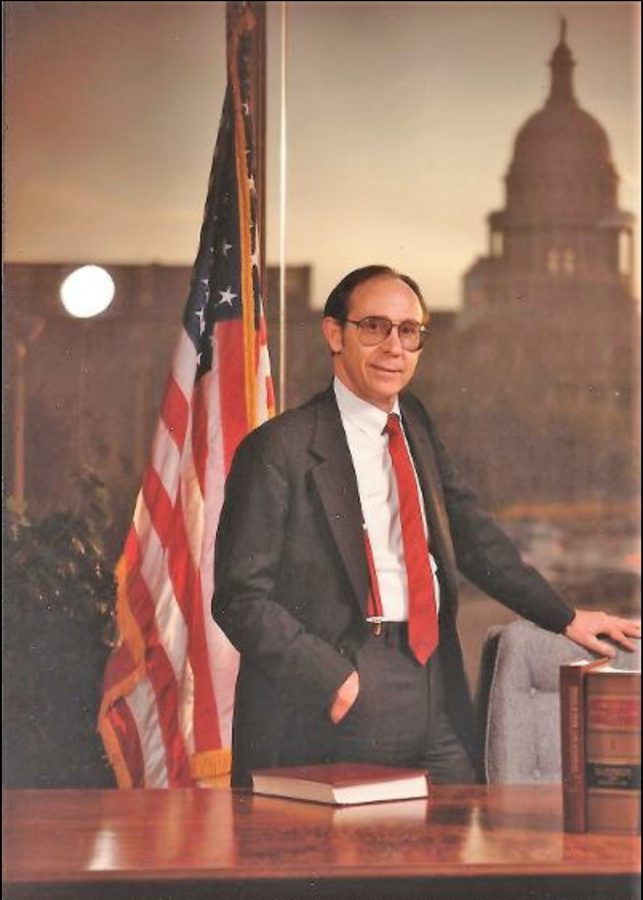 Former TEA commissioner's portrait that still hangs in the TEA boardroom on Congress Avenue in Austin. He stands in front of his office window with a view of the Texas state capitol.
