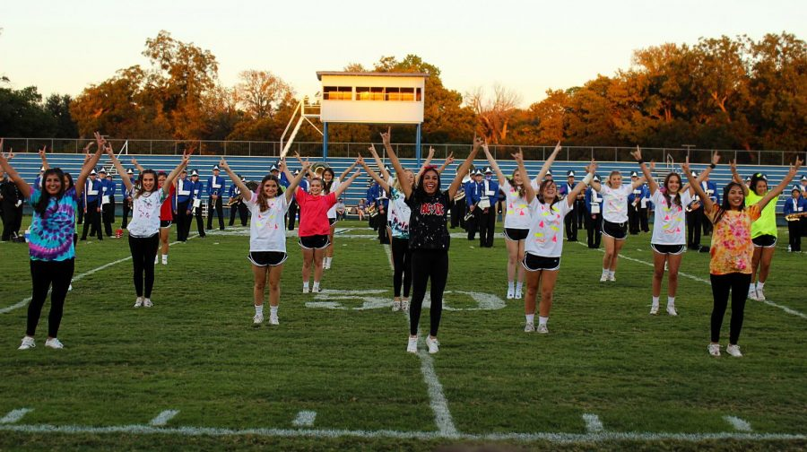 Cheerleaders perform a number at the pep rally.