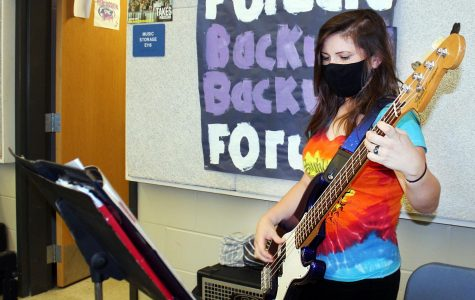 Senior Mariah Perrill practices bass in the band hall.