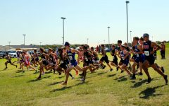 Boys cross country teams begin their 5K against opposing schools at the home cross country meet Oct. 2.