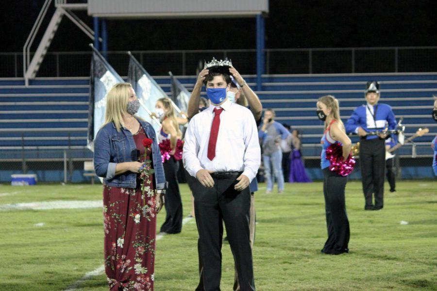 Senior Cole Wheeler gets crowned homecoming king.